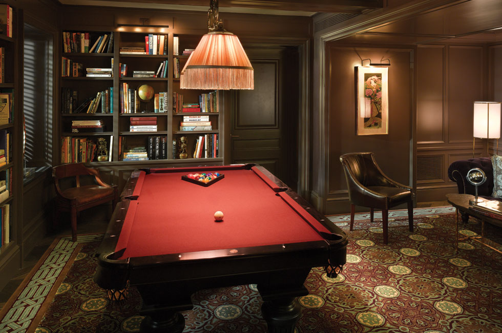 Library featuring artisan billiards table